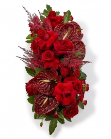 Funeral arrangement with roses and anthurium