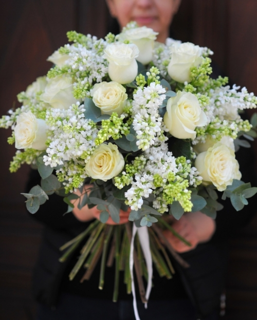 Bouquet with syringa and white roses