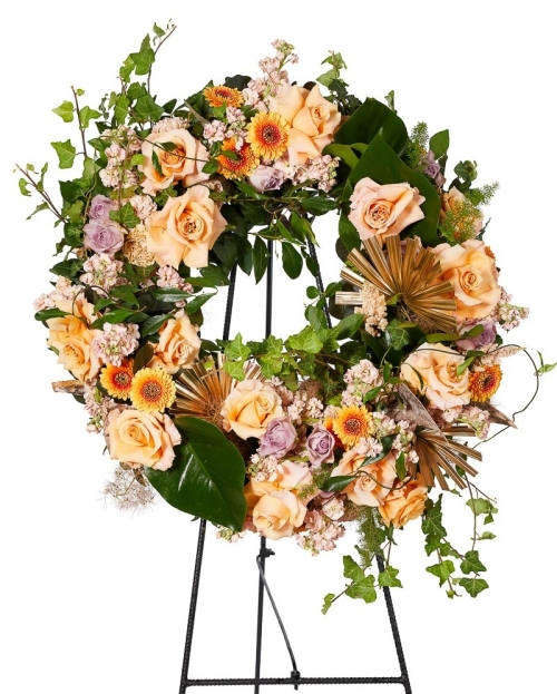 Funeral crown with roses and mathiola