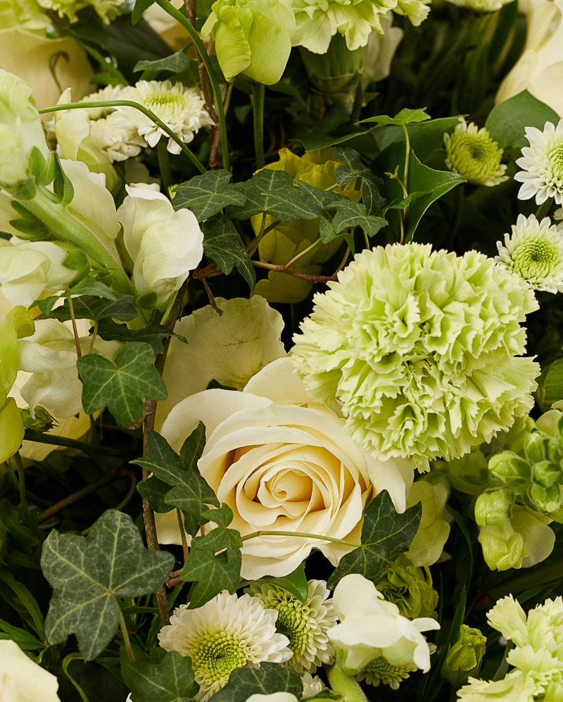Funeral arrangement with roses and santini